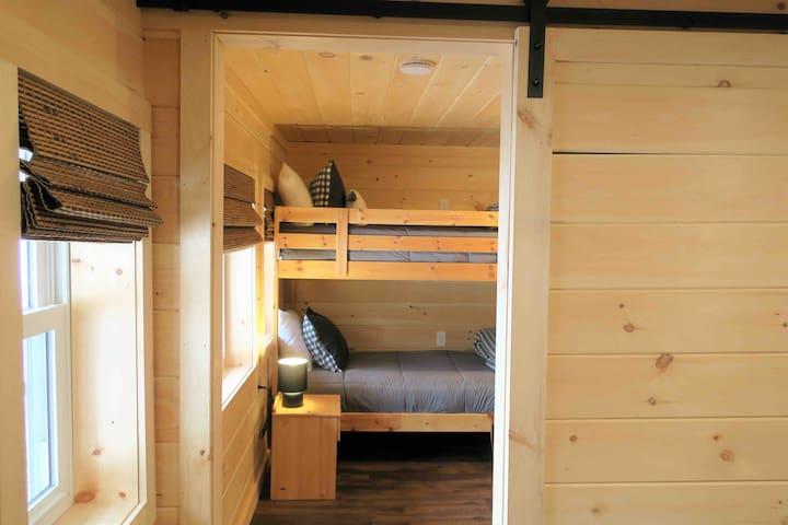 Fully renovated knotty pine basement bedroom with custom made barn doors.