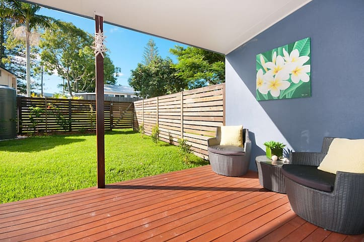 Private balcony, sitting area and fenced in private garden.
