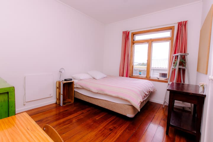 Double bed.  Off lounge