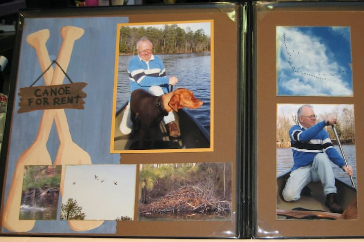 partial scrapbook page of Don and Dolly on the lake, viewing beaver dam and geese flying above.