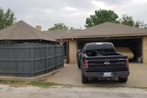 Alley access parking for two cars with easy access to back yard.   Private entrance to master bedroom
