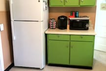 Full eat-in kitchen includes fridge, Keurig coffee maker, microwave, stove, and sink.