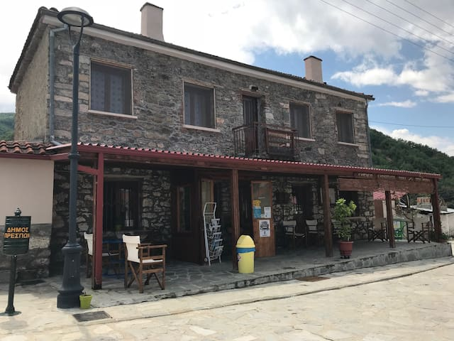 Coffee shop & apartment front  view.
