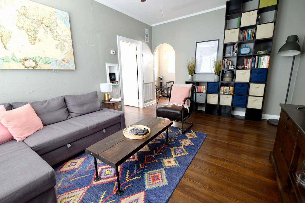 """Main living area with pullout sofa and extra storage. """"Austin's place was quiet, clean and comfortable. Very convenient location. I would definitely stay again!"""" Colter, of New York"""