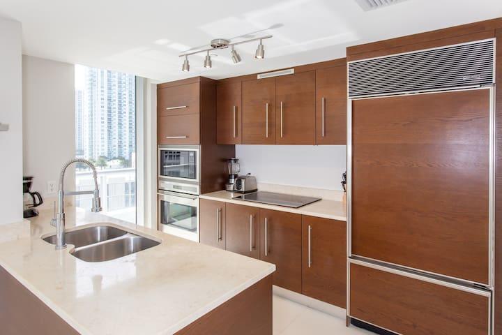 Luxury appliances, including large SubZero fridge. Also window and pantry closet.