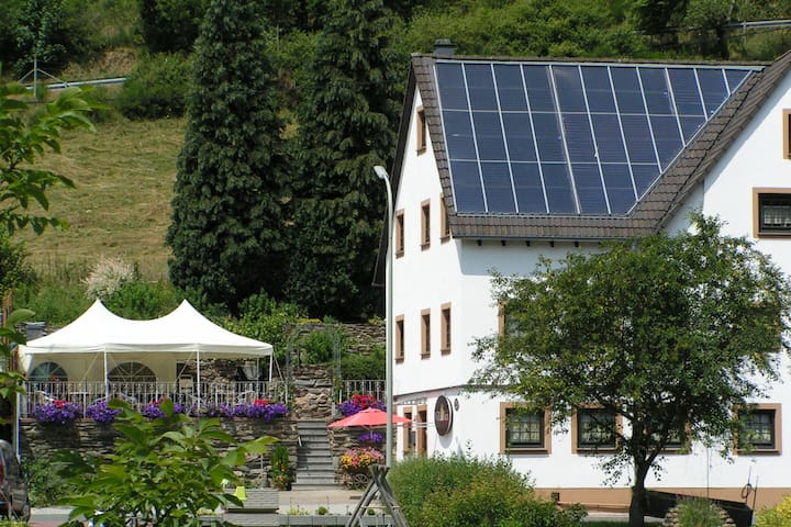 A modern apartment in the Hunsrück region's romantic Drohn Valley.