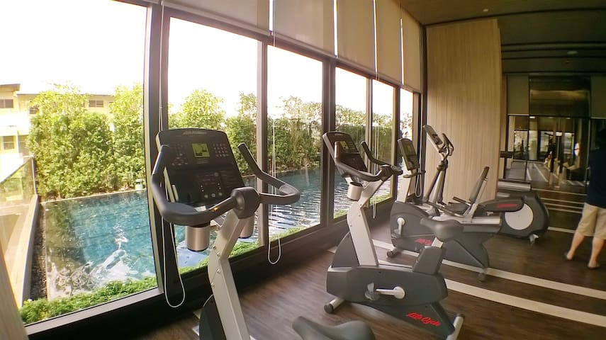 Gym with swimming pool view