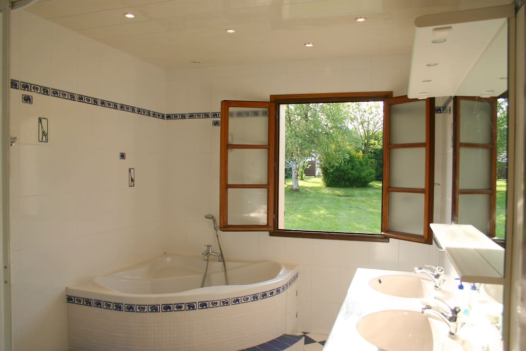 Fantastic airy bathroom with shower and full size bath to relax in