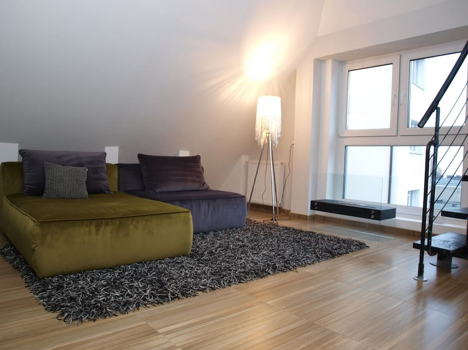 Living room with Sofa that can be used as an extra bed if needed, flat tv