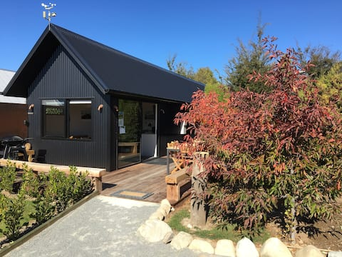 Black Beech House with  luxury cedar outdoor bath.