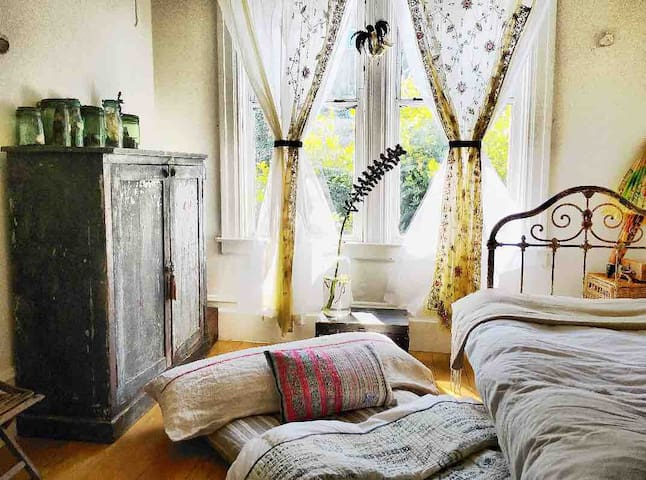The downstairs bedroom has 2 beds if you need them. Both with memory foam mattress's,  linen duvet covers, down comforters & down body pillows.  The floor mattress slides under the other bed when it's not in use.