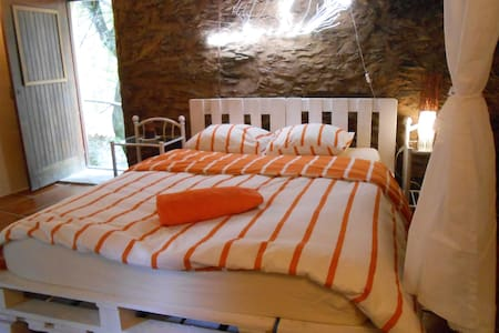 Rustic room with double bed in watermill