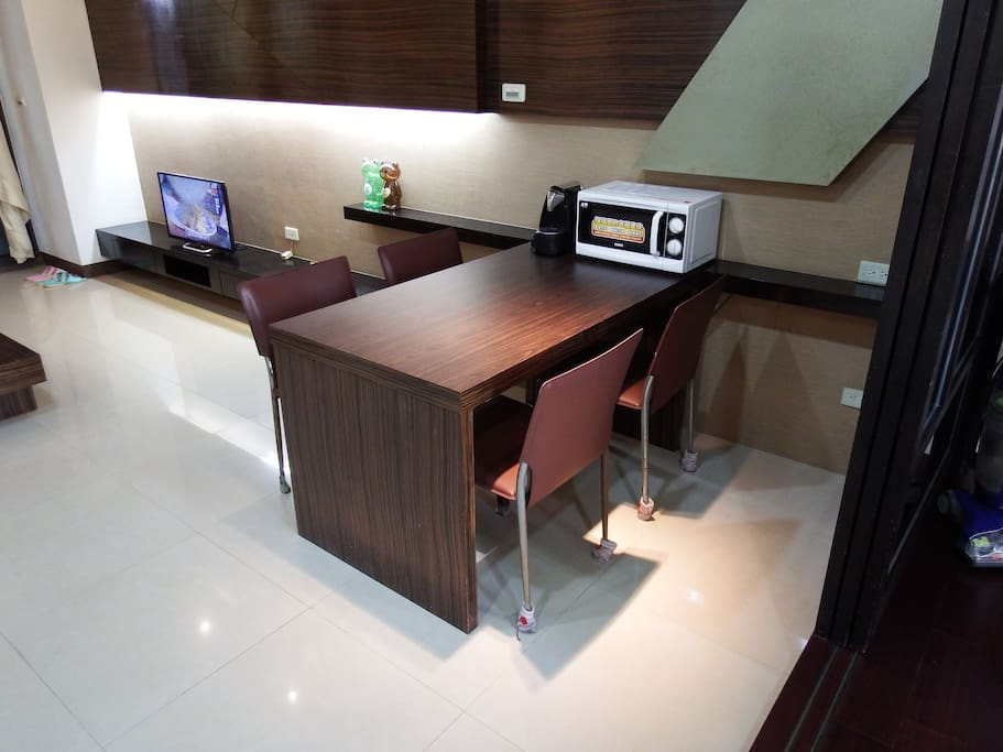 Dining table with microwave and coffee machine