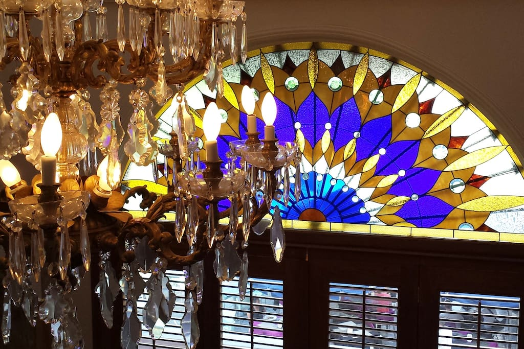 Living room - chandelier & stained glass window