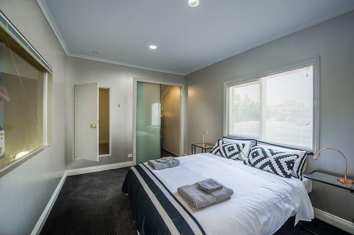Bedroom 2: light and bright, carpeted, walk in wardrobe, attic.