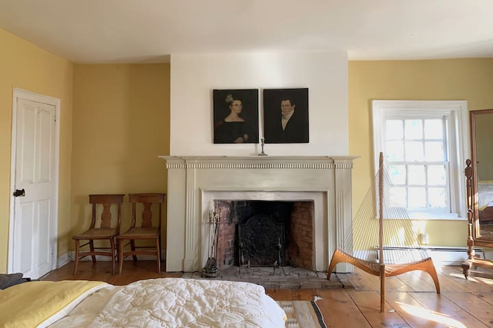 The Yellow Master Bedroom 3 features a wood burning fireplace and a queensize bed