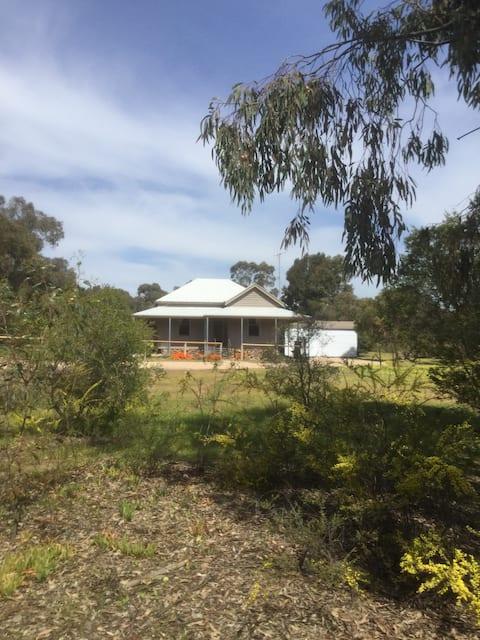 "Bush Setting - ""Ironbark Cottage"""