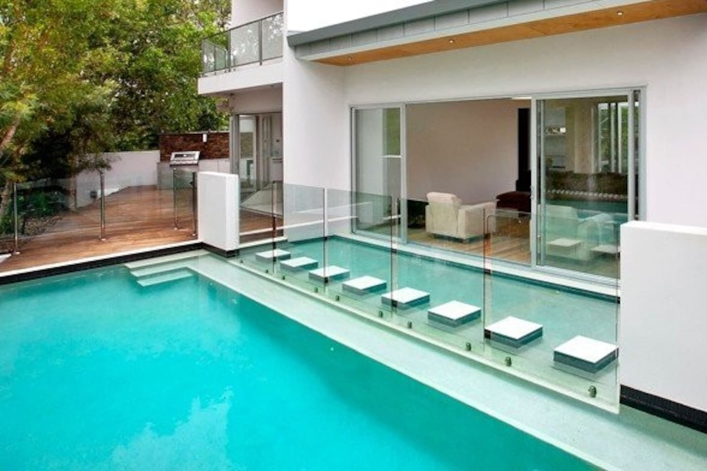 Centrally Located, Private, Architecturally Designed House with North-Facing, Wet-Edge Pool