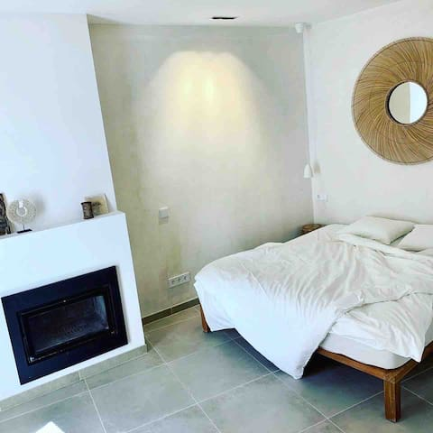 the studio area, where you have the double bed, fire cabin, and also the sofa.