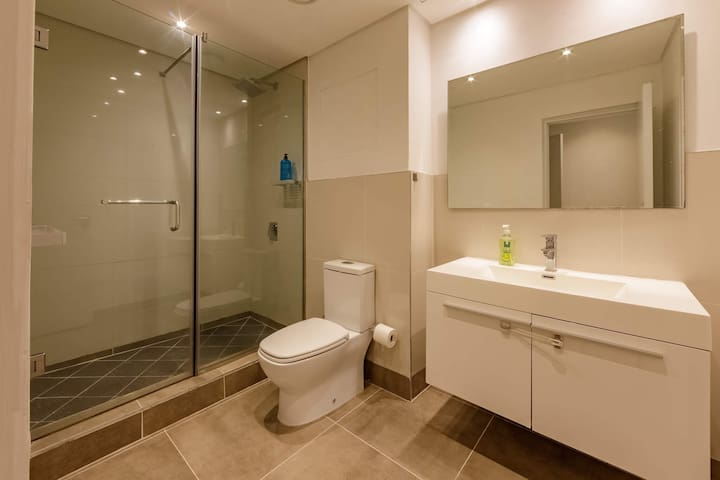 Ensuite bathroom in master bedroom. Upgraded, spacious shower area.