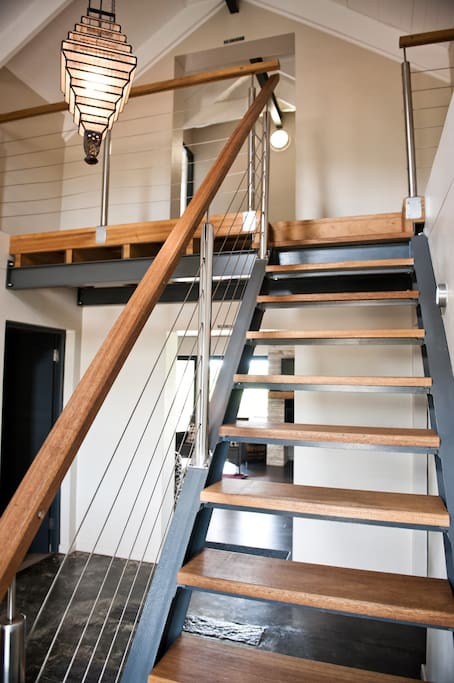 Staircase to two double en suite bedrooms on first floor