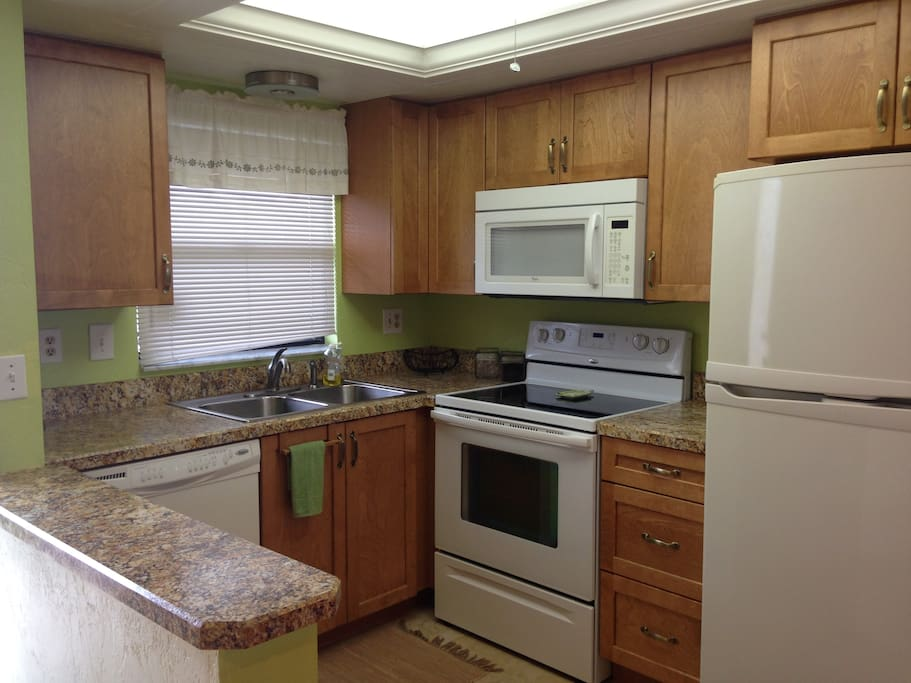 Fully equipped kitchen with everything you could need for cooking, baking, and serving 12.