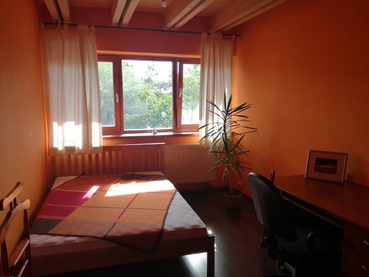 Sunny orange bedroom with private bathroom