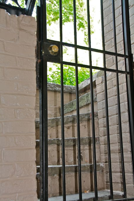 View of front stairs from inside- lock on gate doesn't work, but we can provide a lock if you'd like.