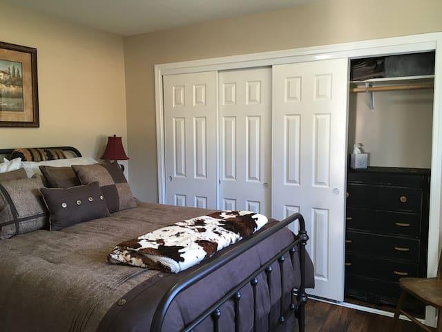 Bedroom with closet queen bed