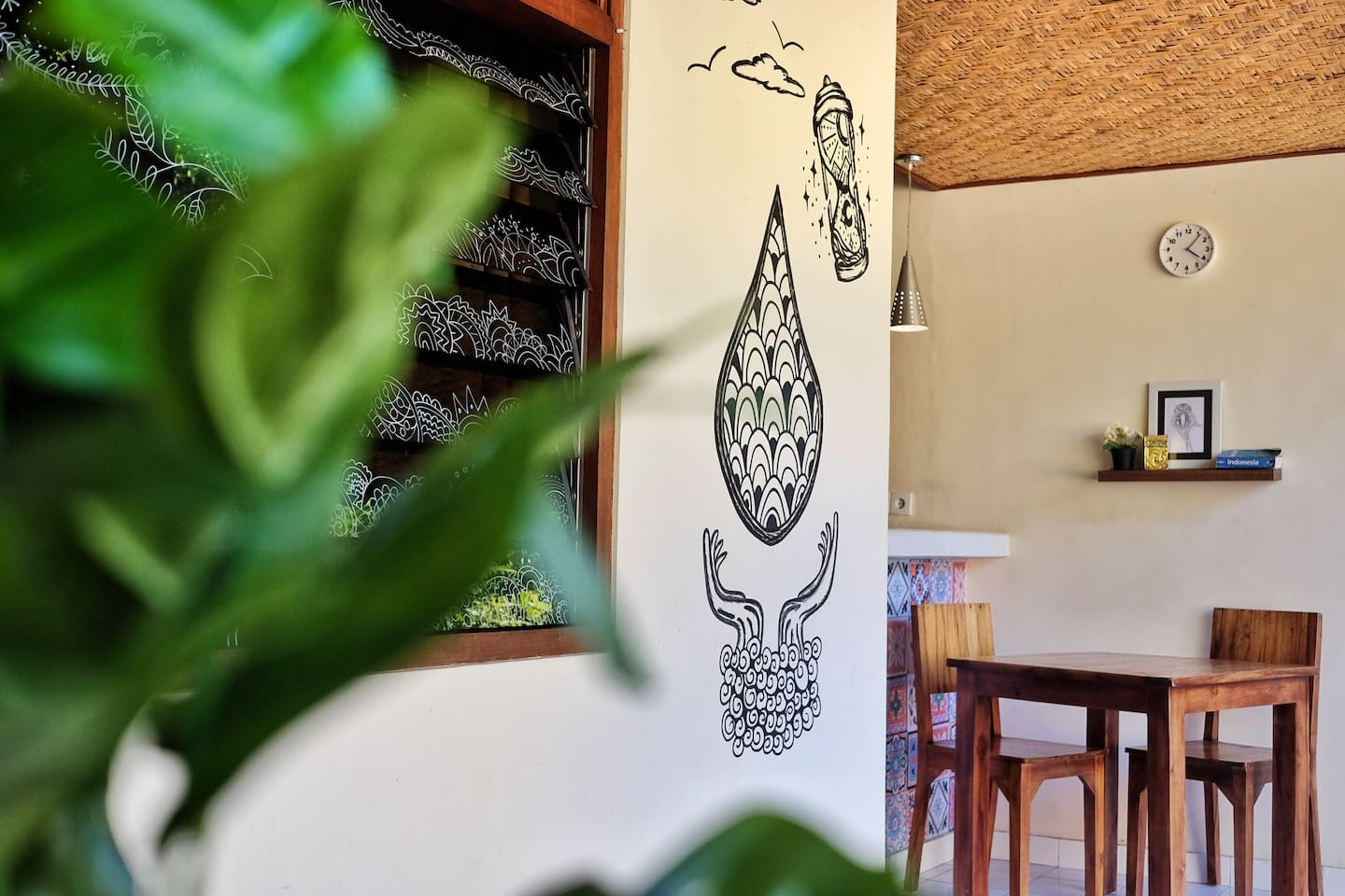 """Roemah Tirta literally means """"Water Home"""". You can expect to see this identity on the murals in the house."""