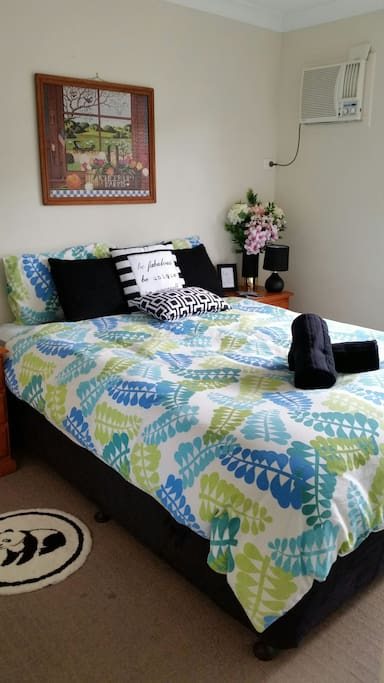 A comfortable Queen Bed and plenty of drawer space!