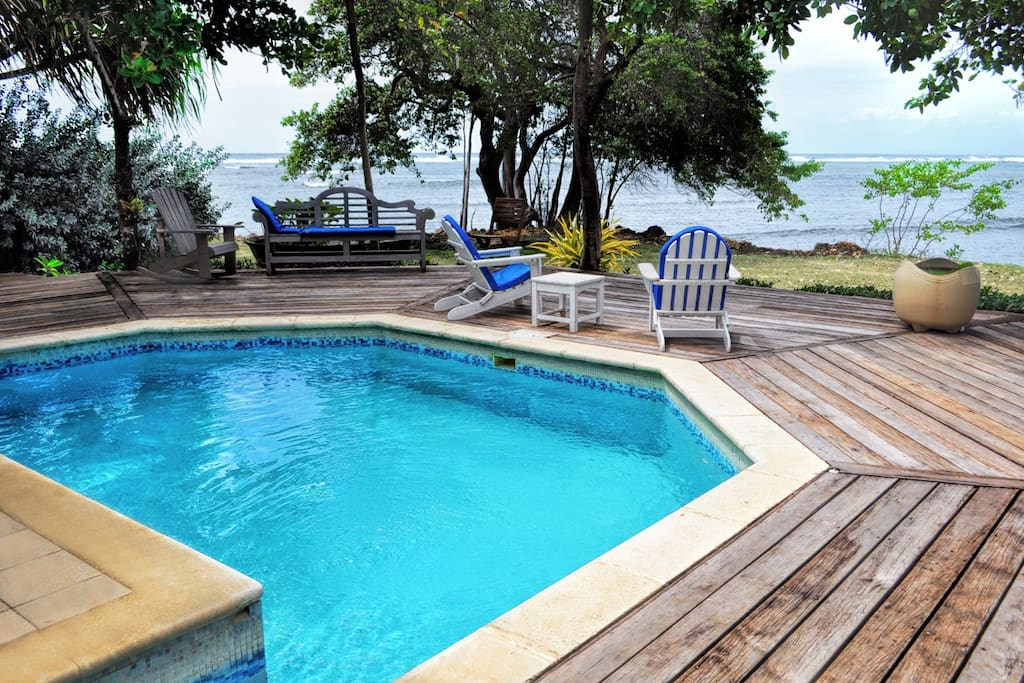 The deck and pool, right on the water