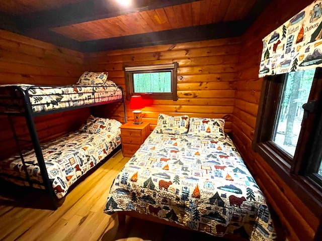 1st floor bedroom offers Twin over twin bunk bed and full bed