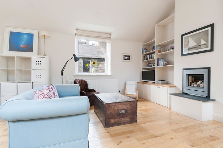 Open plan light and bright living area on first floor