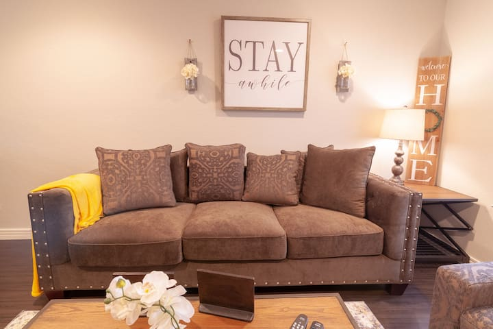 This photo shows a beautiful couch Comfortable for two love birds.
