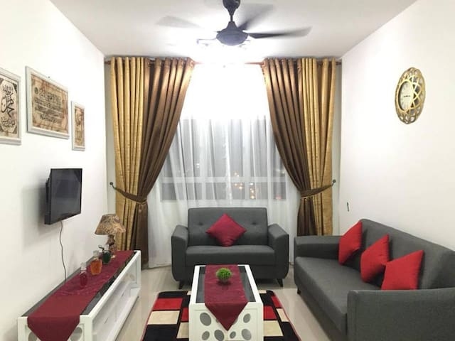 Living Room with beautiful night city view of Kuala Terengganu. Aircond +TV for cosy indoor time.