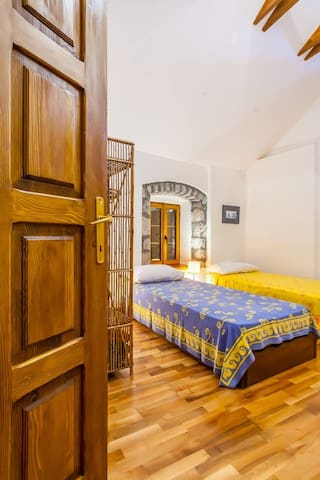 On the second floor, next to the masters bedroom, there is a cozy and large en suite twin room