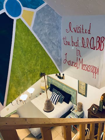 Pic taken from the loft where there is a queen bed, Roku TV and Captain's Lookout.  Notice:  Drop your pin when you drop your selfie with this Laurel, MS hand-painted backdrop.
