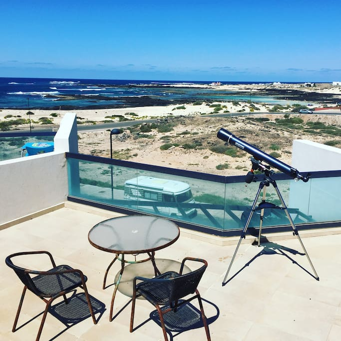 Rooftop Terrace with Sea views, hammock, coffee table & chairs and telescope