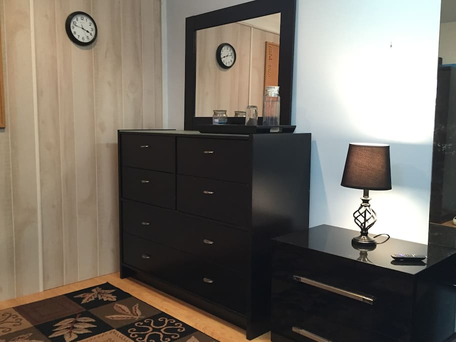 A large dresser with mirror will accommodate you for longer stays. A nightstand and lamp next to the bed, for your comfort.