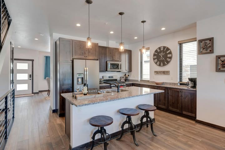Gourmet kitchen with large counter bar
