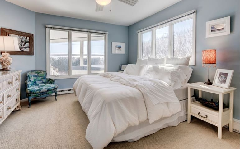 One of two bedrooms on first floor with king bed