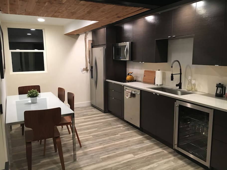 Kitchen/Dining - New stainless steel appliances: refrigerator with ice and filtered water, confection/microwave, dishwasher, cooktop, wine cooler. Modern cabinets with quartz countertops.