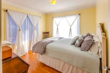 Olympic Homestay: South Guest Room features desk, closet, and plenty of natural light.