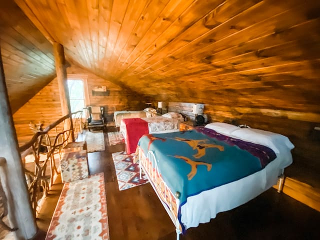 3 out of 4 beds, located in the above loft.
