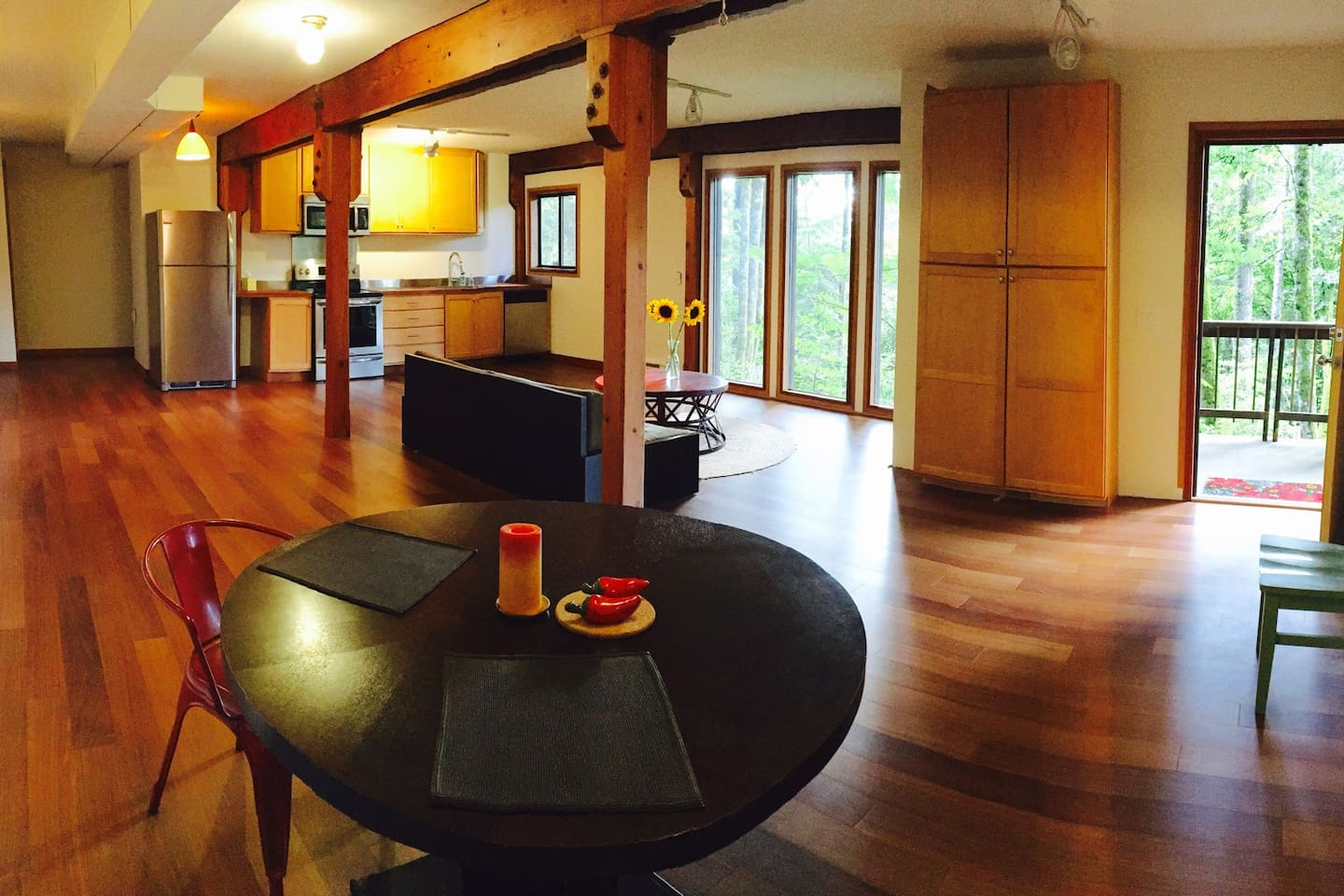 Just enough panorama to show the whole room and the outside trees. This space is canteleivered out above ground. It's about 30' long x 20' wide, plus the bedroom and bath are behind the kitchen, and those are nice sizes, too.