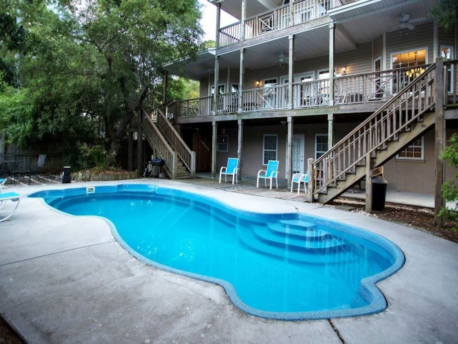 Full Size Swimming Pool and Covered Patio in the Back Yard