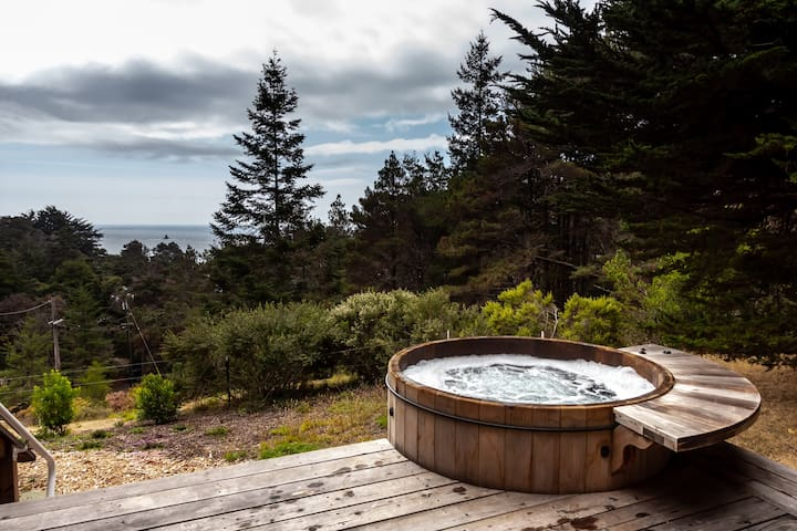 Relax in the Cedar Hot Tub surrounded by forest and ocean.