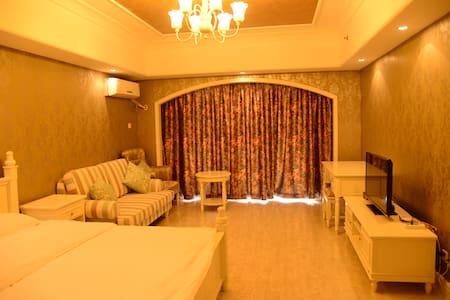 孤独图书馆三联海边图书馆附近高层园景海景公寓908/910 - Qinhuangdao
