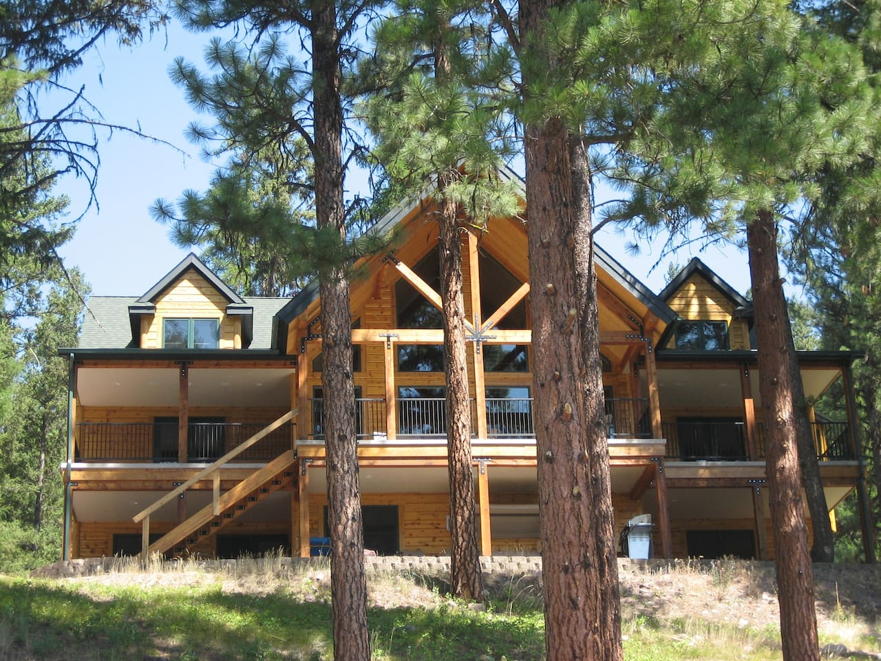 Log Home on Salmon Lake with Shoreline Frontage and Dock